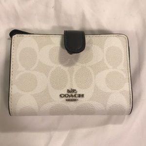 White monogram coach wallet